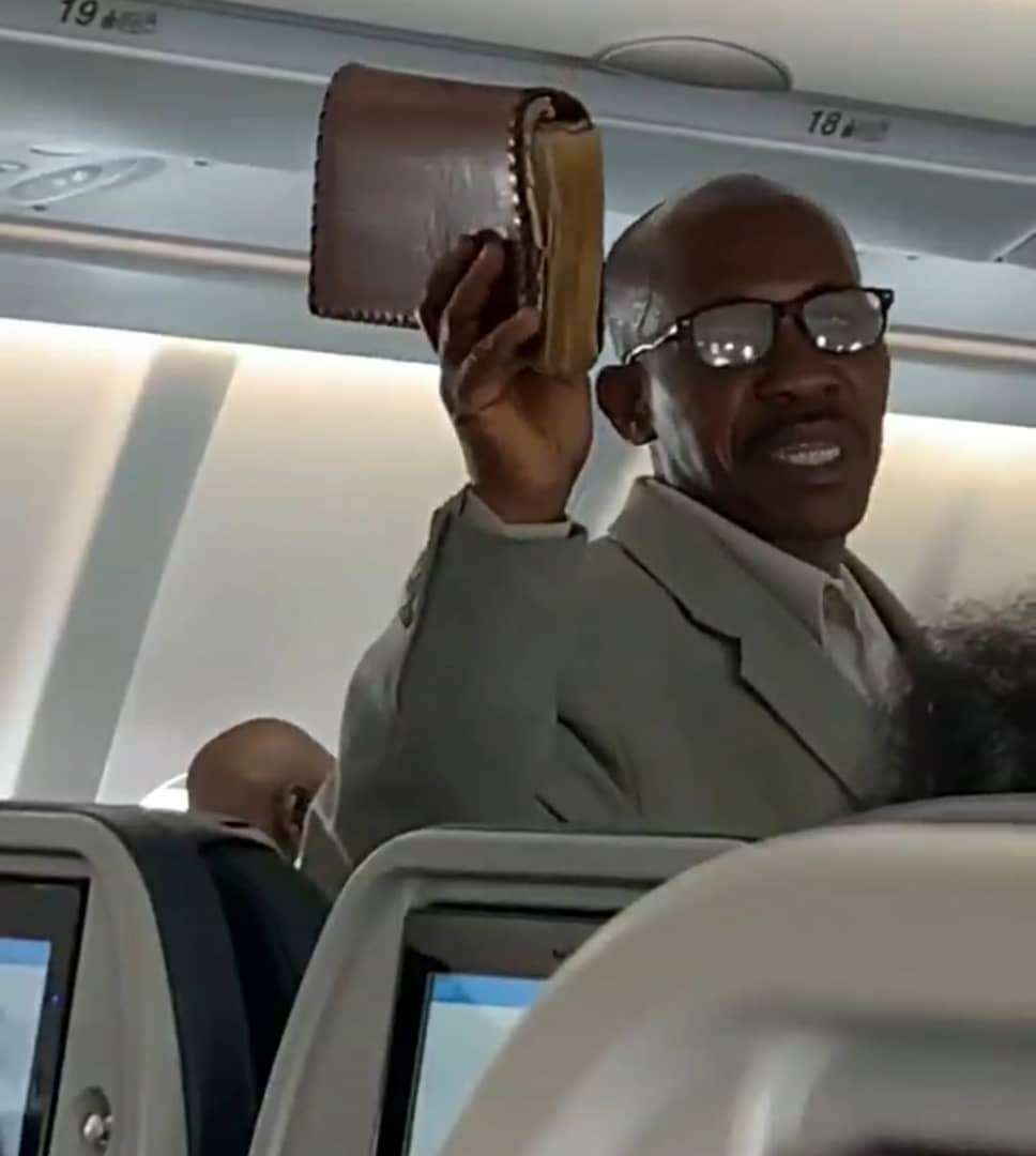 African man preaching the gospel onboard a flight