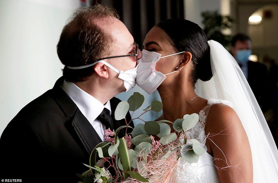 Newlyweds kiss via protective masks in Italy [PHOTOS]