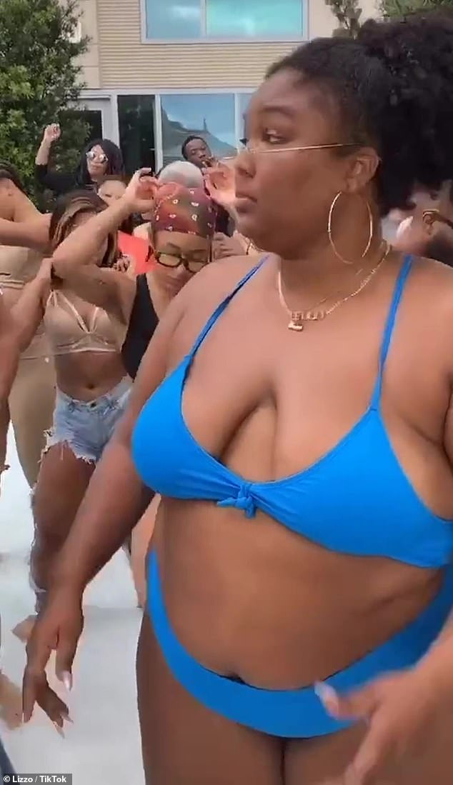 Singer, Lizzo shows off her body in cleavage baring bikini